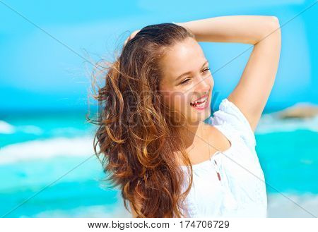 Beautiful Girl in Tropical Resort. Travel and Vacation concept. Beauty young healthy woman enjoying vacation over ocean background. Caribbean Holidays