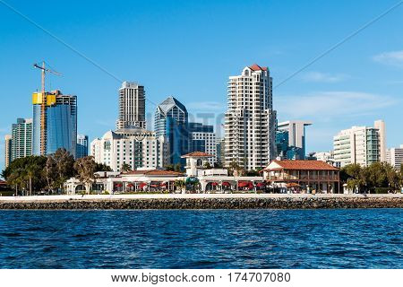 SAN DIEGO, CALIFORNIA - MARCH 2, 2017:  Downtown skyline with new construction and the Seaport Village shopping and dining complex.