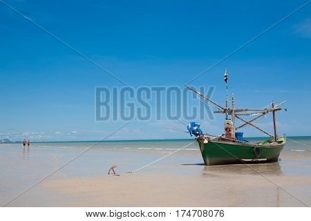 small fishing boat on the sea beach