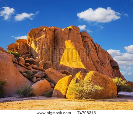 Stone of Spitzkoppe, Namibia. Play of light and shadow on the rocks. Concept of extreme and ecological tourism. The granite outcrops in the Desert Namib