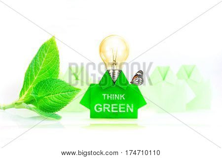 Green origami shirt paper Light bulb Think green and eco friendly concept.