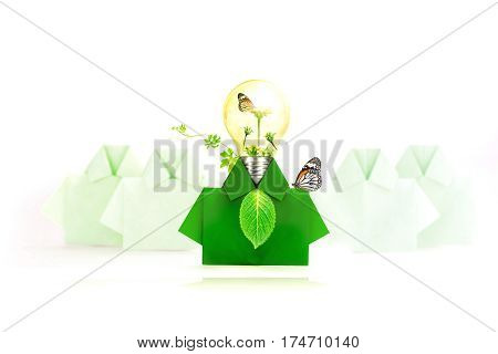 Green origami shirt paper Light bulb with flower tree and butterfly inside Think green and eco friendly concept.