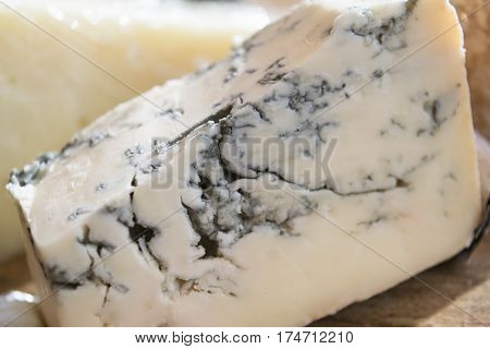 detail of a piece of french roquefort cheese