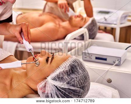 Spa days for 2 . Couple facial massage beauty salon. Electric stimulation woman and man skin care . Professional equipment microcurrent lift face. Anti aging rejuvenation and non surgical treatment.
