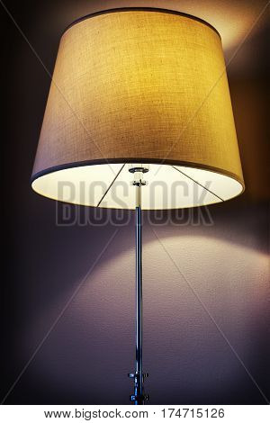 floor lamp with textile shade. Vignetting as an artistic effect