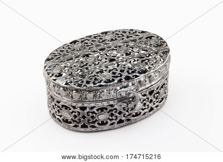 Metal carved jewelry box on white background
