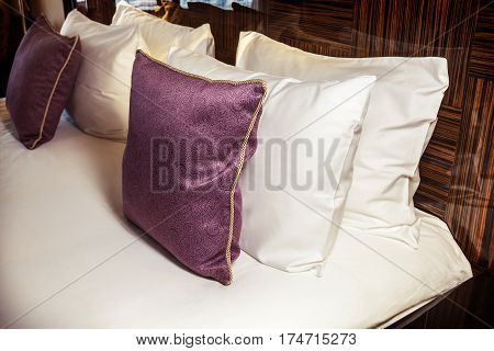 Pillow different to not laid by the bed. home textile. Vignetting as an artistic effect