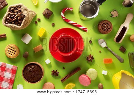 empty cup of coffee at green surface background