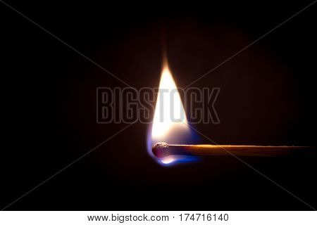 Burning match on a black background, fire, light