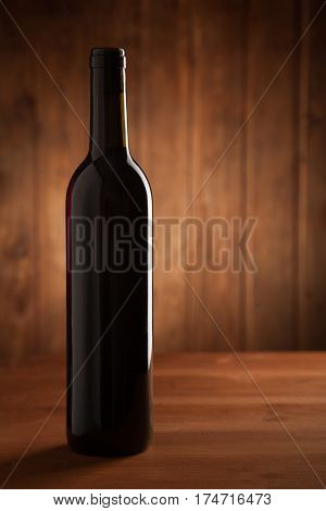 bottle of wine on an old wooden table