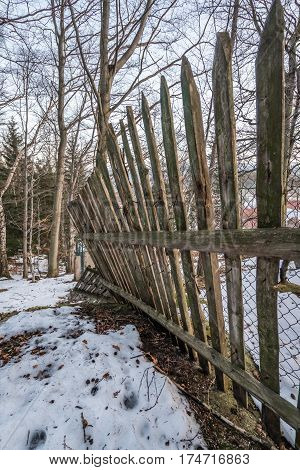 Close up of an old wooden fence in winter