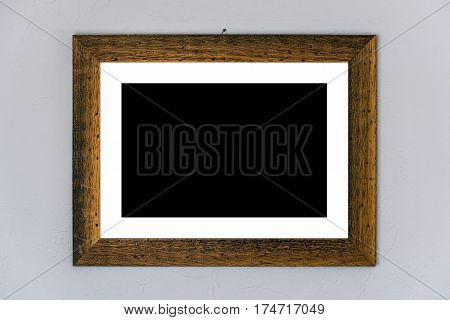 Blank picture placeholder in wooden frame with Passe-partout copy space for painting or photograph on the wall
