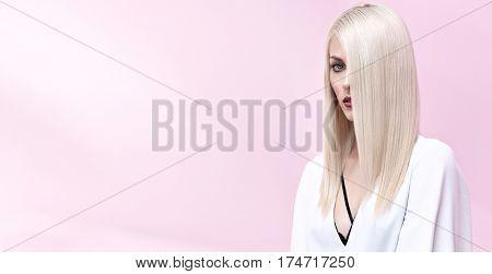 Elegancy stylish glamour girl in white dress - on pink background