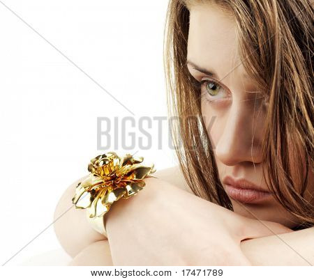 Green-Eyed Beauty Tired Girl with Gold Jewelry