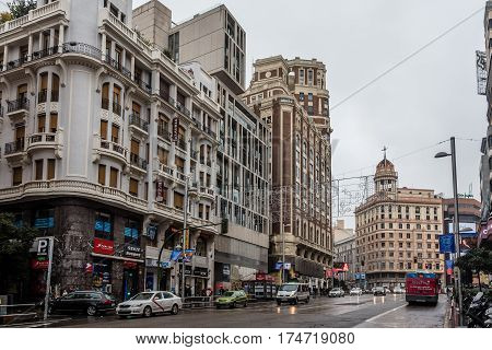 Madrid Spain - November 20 2016: Rainy day in Gran Via in Madrid. It is an ornate and upscale shopping street located in central Madrid. It is known as the Spanish Broadway.