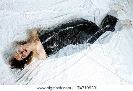 Pretty girl wrapped in black foil. Hard depression