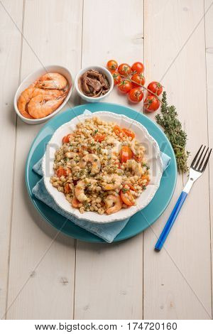 barley salad with shrimp anchovies and tomatoes
