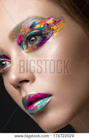 Beautiful girl with creative colorful makeup. Beauty face. Photos shot in studio