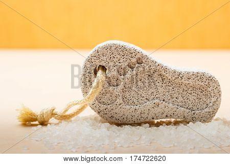 Feet care. Pedicure accessory tool: stone pumice with foot print closeup