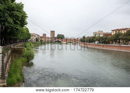 Adige River and Ponte Pietra in Verona . Italy