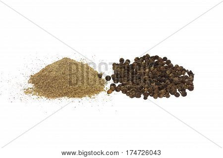 black ground (milled) pepper and black pepper whole peas side view isolated on white background
