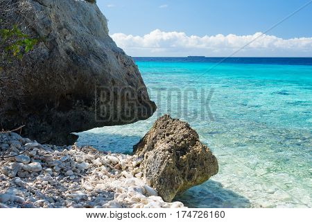 Rocks and clear blue water - swim paradise on tropical Curacao island all seasons