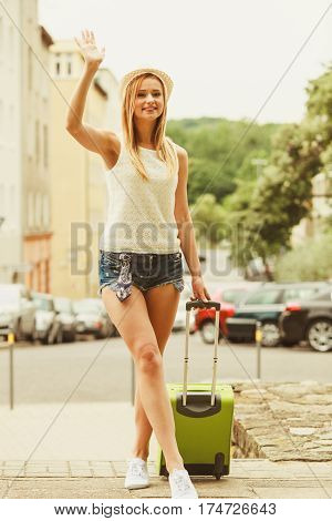 Woman Traveler With Suitcase Waiting For Car.