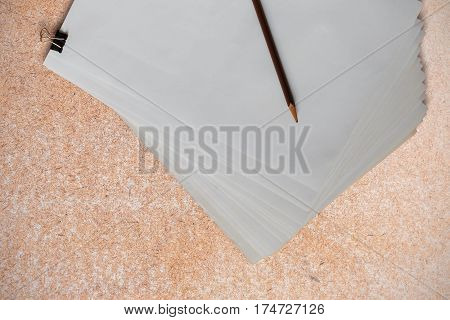 Paper and pencil on the old wooden floor.
