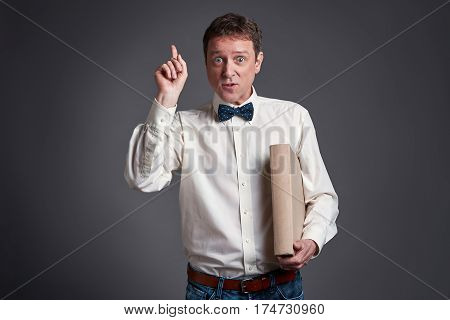 Middle age man wants attention in a shirt and a bowtie