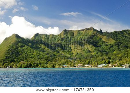 View on Mount Otemanu through turquoise lagoon, palms, and overwater bungalows on the tropical island Bora Bora, honeymoon destination, near Tahiti, French Polynesia, Pacific ocean.HDR picture.