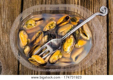 Marinated mussels in brine. Studio Food Photo
