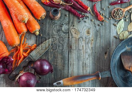 fresh vegetables on the gray wooden surface empty space in the middle