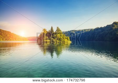 Vivid view on turquoise water in sunny day. Picturesque and gorgeous scene. Popular tourist attraction. Location famous resort Plitvice Lakes National Park, Croatia, Europe. Beauty world.