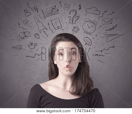 A dark brown haired pretty teenage girl with thoughts in her head illustrated by question mark, rocket, money, coffee, clock, email, social life icons drawn on the background wall concept.