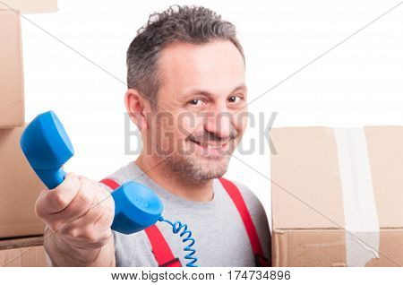 Selective Focus Of Mover Man Holding Telephone Receiver