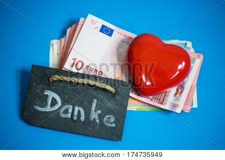 Heart lies on banknotes € Danke = Thank you