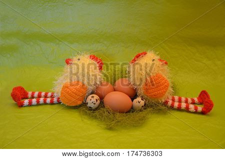 Easter scene with chick and eggs against yellow background