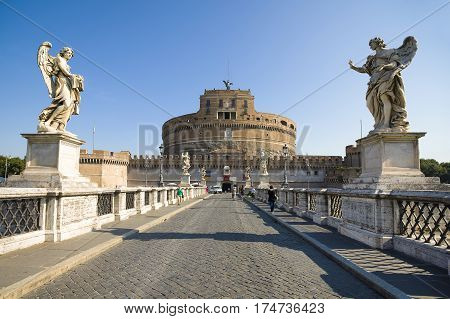 ROME ITALY - AUGUST 26 2016: View to from Ponte Sant'Angelo bridge to Castel Sant'Angelo Rome Italy August 26 2016