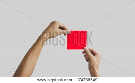 Two Hands Holding Square Paper In The Hand. Leaflet Presentation. Pamphlet Hand Man. Man Show Offset