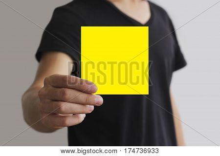 Man Showing Blank Yellow Square Flyer Brochure Booklet. Leaflet Presentation. Pamphlet Hold Hands. M