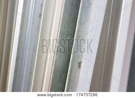 Metal drywall grey profiles steel. Close up