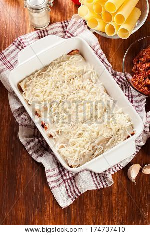 Cannelloni Stuffed With Meat Cooked In A Casserole Dish Ready Fo