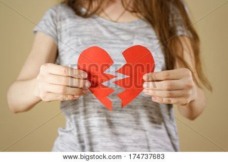 Female Hands Holding Broken Blank Empty Red Valentines Card With Heart On A White Background