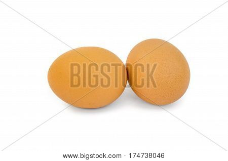 Two brown eggs isolated on a white background cutout