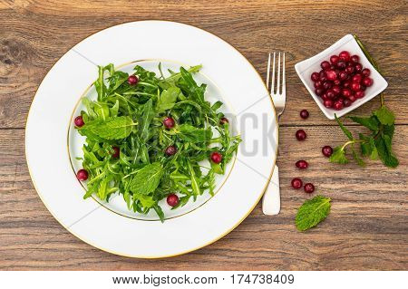 Vegetarian salad of arugula, mint, berries and Studio Photo