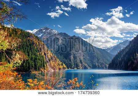 Beautiful View Of The Long Lake Among Mountains And Fall Woods
