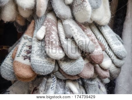 hand knitted downy mittens in the market.