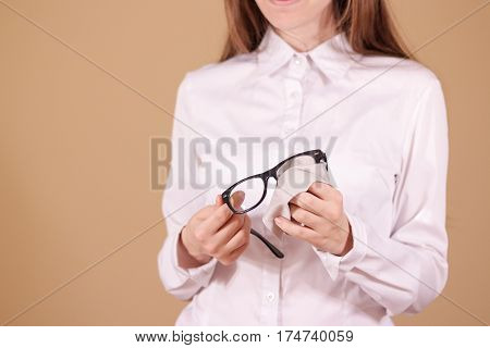 Women Hand Cleaning Glasses Lens With Isolated Background