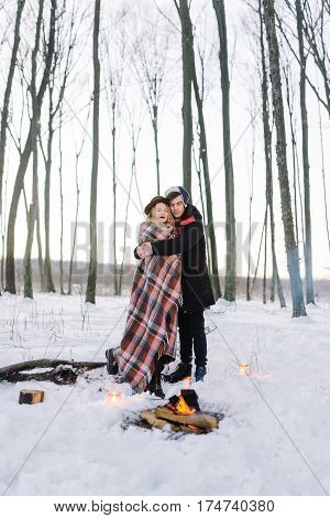 A loving couple walking in winter. Lovers of dance and run. He hugs her and cherishes its warmth