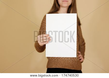 Girl Holding White A4 Blank Paper Vertically. Leaflet Presentation. Pamphlet Hold Hands. Woman Show